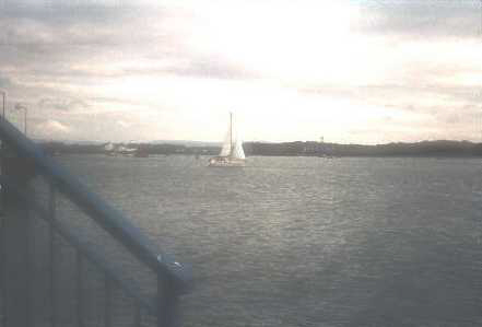 Yacht sailing down the River Wyre to Fleetwood Marina